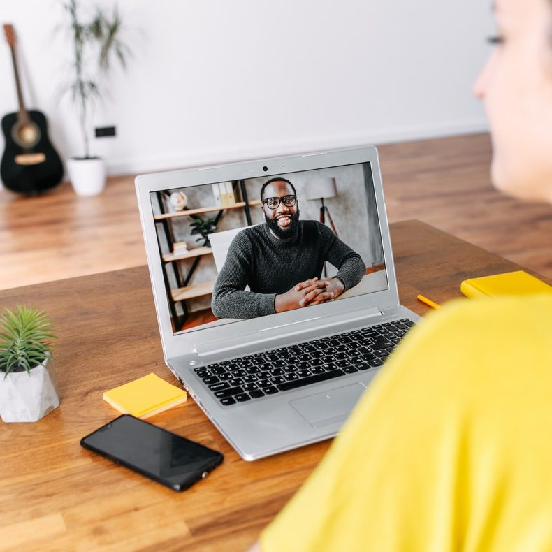 woman on video call with man on laptop